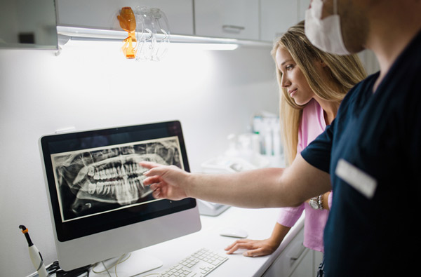 Dentist reviewing a digital x-ray in Chehalis, WA